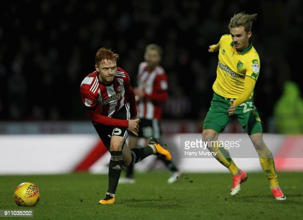 Ryan Woods of Brentford in action under pressure from James Maddison of Norwich City during the Sky Bet Championship match between Brentford and...