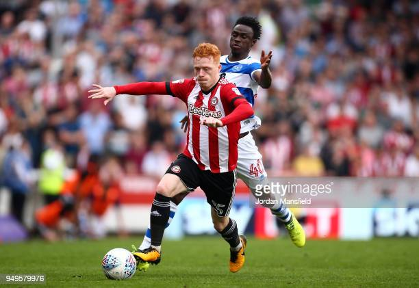 Ryan Woods of Brentford tackles with Idrissa Sylla of QPR during the Sky Bet Championship match between Brentford and Queens Park Rangers at Griffin...