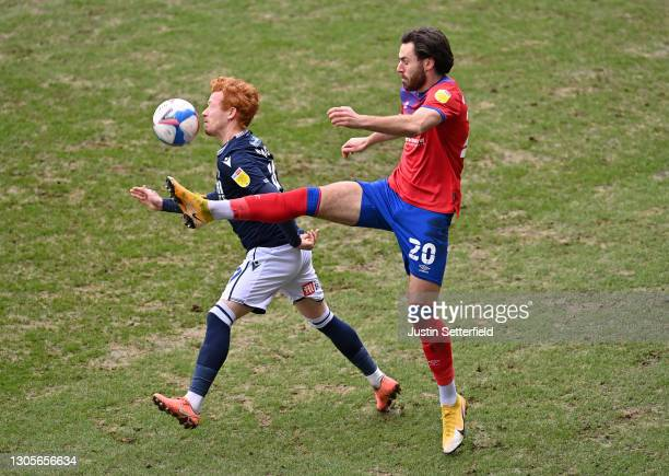 Ryan Woods of Millwall FC and Ben Brereton of Blackburn Rovers battle for the ball during the Sky Bet Championship match between Millwall and...