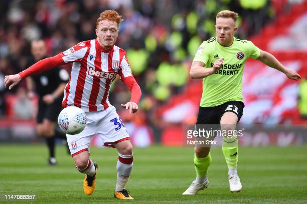 Ryan Woods of Stoke City and Mark Duffy of Sheffield United chase the ball during the Sky Bet Championship match between Stoke City and Sheffield...