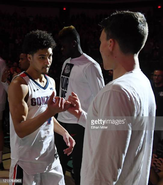 Ryan Woolridge of the Gonzaga Bulldogs is greeted on the court by Matthew Lang during player introductions before taking on the Saint Mary's Gaels in...