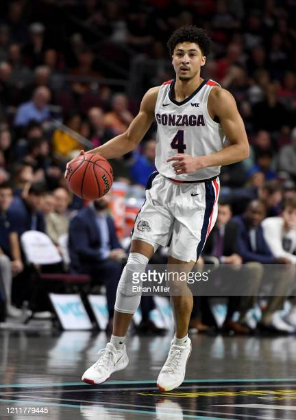 Ryan Woolridge of the Gonzaga Bulldogs brings the ball up the court against the Saint Mary's Gaels during the championship game of the West Coast...
