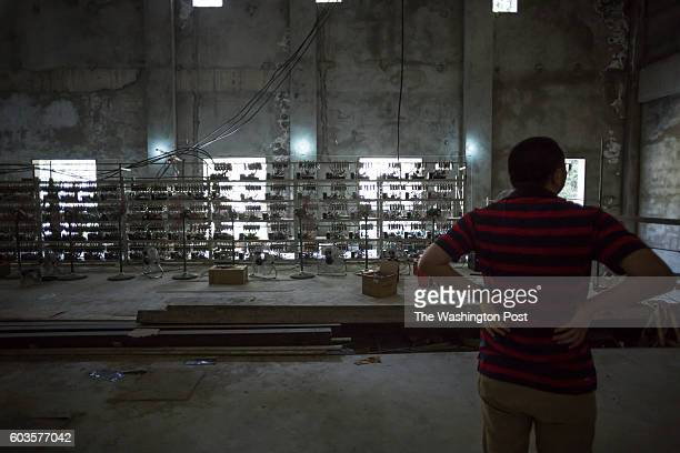 KONGYUXIANG GARZE SICHUAN CHINA AUGUST 12 Ryan Xu chief strategy officer and cofounder of Bitcoin Group Limited shows off mining equipment inside his...