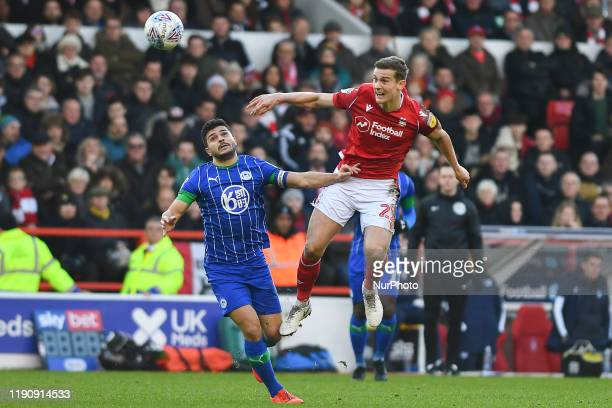 Ryan Yates of Nottingham Forest wins the ball from Sam Morsy of Wigan Athletic during the Sky Bet Championship match between Nottingham Forest and...