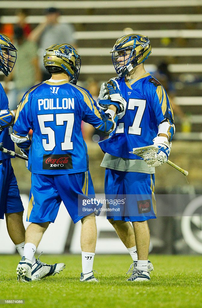 Ryan Young #27 of the Charlotte Hounds celebrates with teammate Peet Poillon #57 after scoring one of his team record seven goals on the night against the Rochester Rattlers at American Legion Memorial Stadium on May 11, 2013 in Charlotte, North Carolina. The Rattlers defeated the Hounds 13-10.