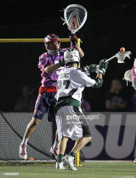 Ryan Young of the Long Island Lizards shoots on net against Jordan Burke of the Boston Cannons at Harvard Stadium June 9 2012 in Boston Massachusetts