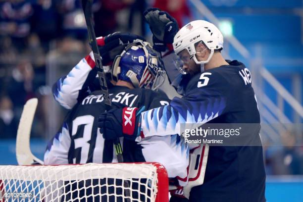 Ryan Zapolski amd Noah Welch of the United States celebrate after defeating Team Slovakia in the Men's Play-offs Qualifications game on day eleven of...