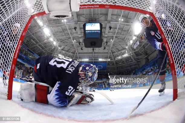 Ryan Zapolski of the United States and Matt Gilroy of the United States react after Andrej Kudrna of Slovakia scores during the Men's Ice Hockey...