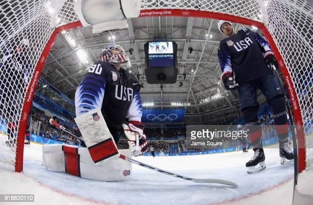 Ryan Zapolski of the United States and Matt Gilroy of the United States react after Andrej Kudrna of Slovakia scores during the Men's Ice Hockey...
