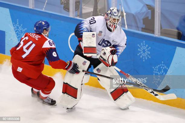 Ryan Zapolski of the United States controls the puck against Jiri Sekac of the Czech Republic in the second period during the Men's Playoffs...