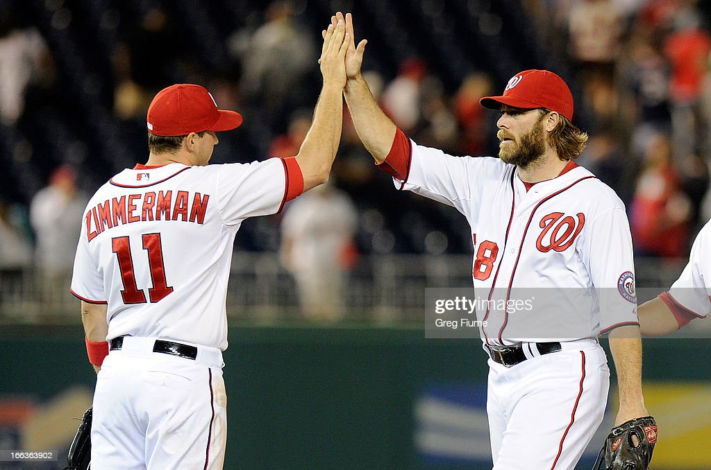 Ryan Zimmerman #11 and Jayson Werth #28 of the Washington Nationals celebrate after a 7-4 victory against the Chicago White Sox at Nationals Park on April 11, 2013 in Washington, DC.