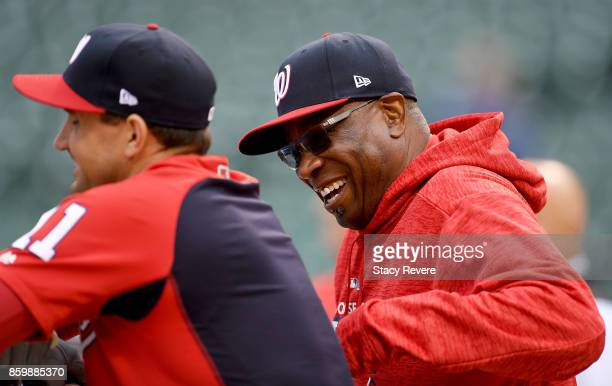 Ryan Zimmerman and manager Dusty Baker of the Washington Nationals laugh before game four of the National League Division Series against the Chicago...