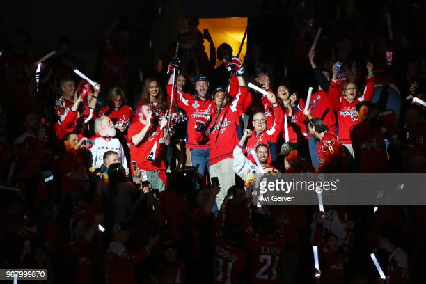 Ryan Zimmerman and Max Scherzer of the Washington Nationals cheer on the Capitals with the fans during the first period of Game Four of the 2018 NHL...