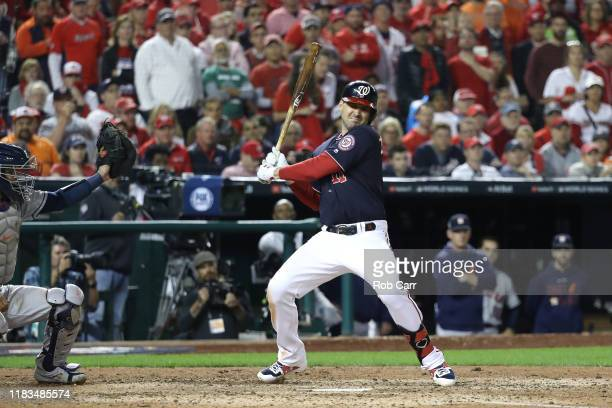 Ryan Zimmerman of the Washington Nationals avoids being hit by the pitch against the Houston Astros during the fifth inning in Game Three of the 2019...
