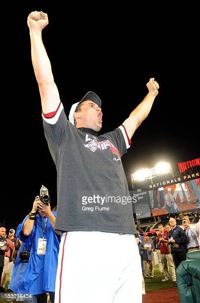 Ryan Zimmerman of the Washington Nationals celebrate after winning the National League East Division Championship after the game against the...
