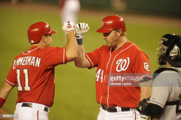 Ryan ZImmerman of the Washington Nationals celebrates a home run with Adam Dunn during a baseball game against the Florida Marlins on May 7 2010 at...