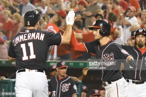 Ryan Zimmerman of the Washington Nationals celebrates a two run home run with Trea Turner in the eight inning during a baseball game against the New...