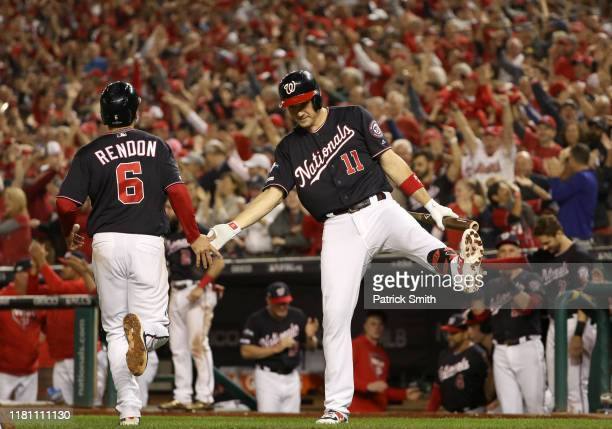 Ryan Zimmerman of the Washington Nationals celebrates after Anthony Rendon scored on an RBI double by Howie Kendrick in the fifth inning of game...