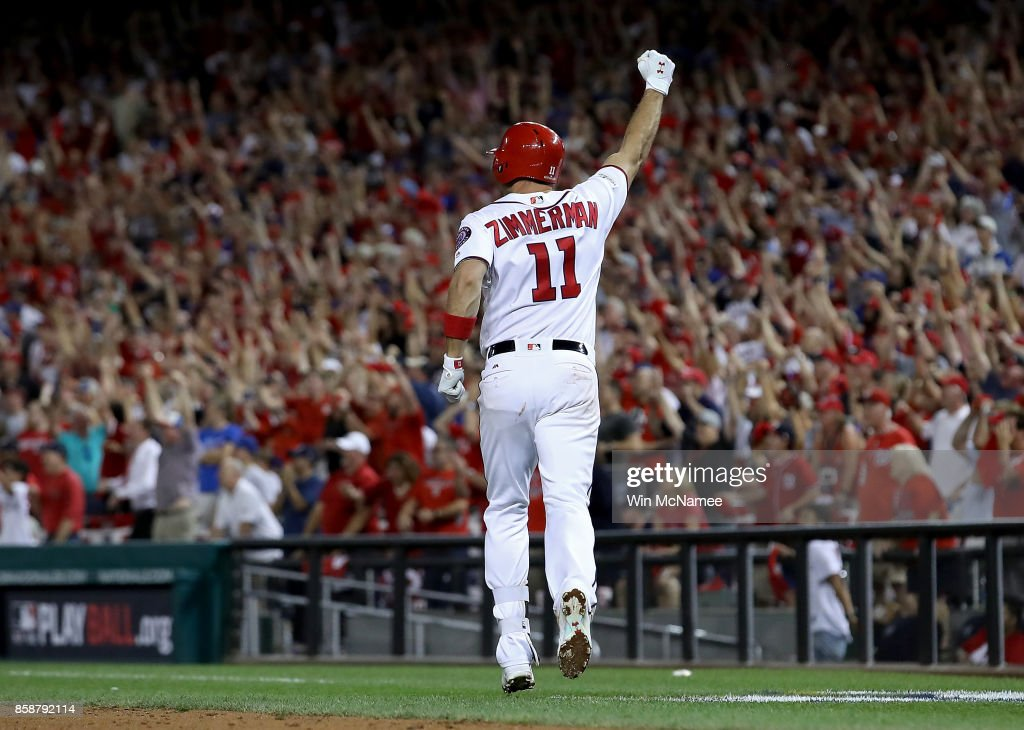 Ryan Zimmerman #11 of the Washington Nationals celebrates after hitting a game winning 3 run home run against the Chicago Cubs in the eighth inning during game two of the National League Division Series at Nationals Park on October 7, 2017 in Washington, DC. The Nationals won the game 6-3.
