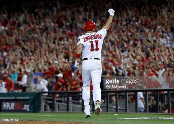 Ryan Zimmerman of the Washington Nationals celebrates after hitting a game winning 3 run home run against the Chicago Cubs in the eighth inning...