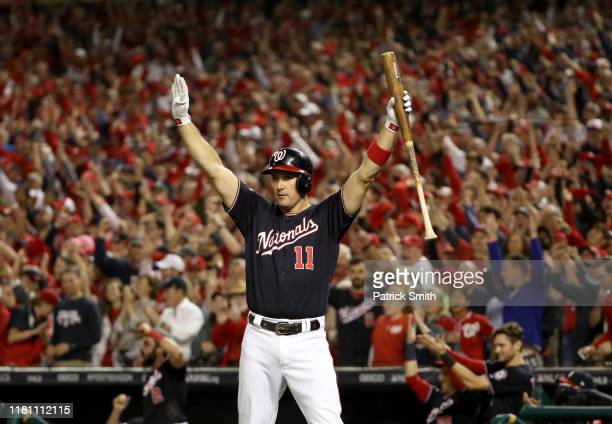 Ryan Zimmerman of the Washington Nationals celebrates an RBI double hit by teammate Howie Kendrick in the fifth inning of game three of the National...