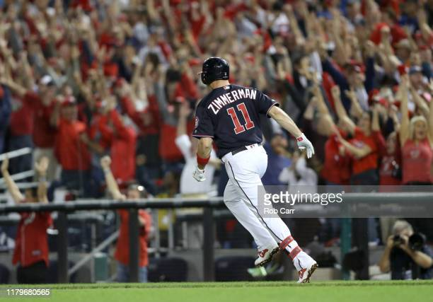 Ryan Zimmerman of the Washington Nationals celebrates as he runs the bases on his three run home run in the fifth inning of game four of the National...