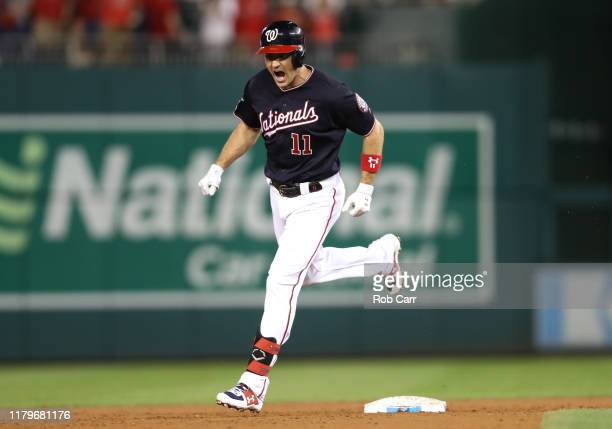 Ryan Zimmerman of the Washington Nationals celebrates as he runs the bases after his three run home run in the fifth inning of game four of the...
