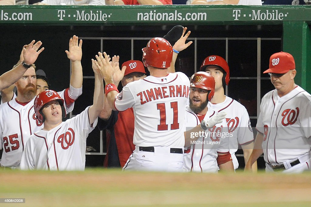 Ryan ZImmerman #11 of the Washington Nationals celebrates scoring the winning run on Nate McLouth #15 (not pictured) sacrifice fly in the seventh inning during a baseball game against the Houston Astros on June 18, 2014 at Nationals Park in Washington, DC. The Nationals won 6-5.