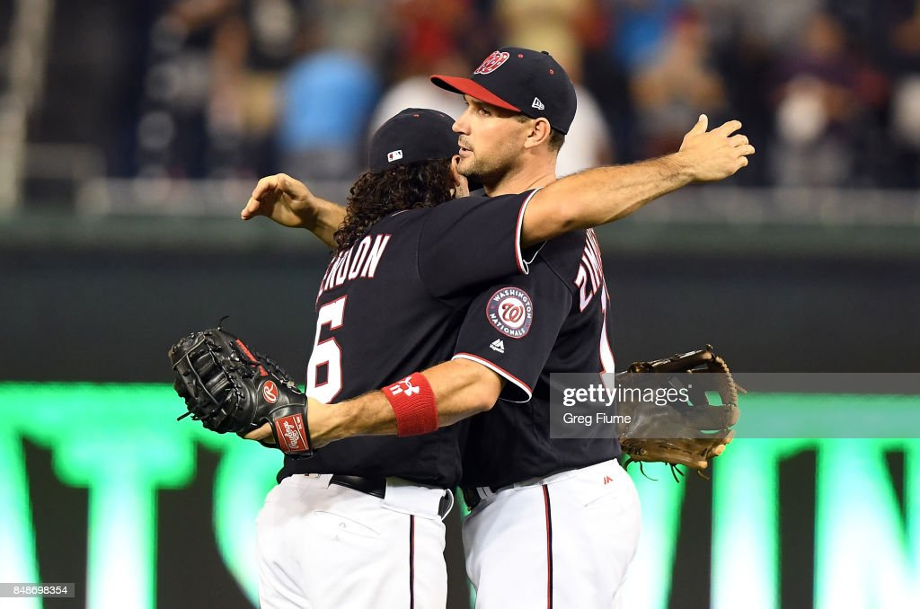 Ryan Zimmerman #11 of the Washington Nationals celebrates with Anthony Rendon #6 after a 7-1 victory against the Los Angeles Dodgers at Nationals Park on September 17, 2017 in Washington, DC.