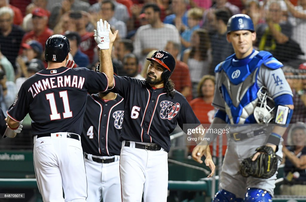 Ryan Zimmerman #11 of the Washington Nationals celebrates with Anthony Rendon #6 after hitting a three-run home run in the sixth inning against the Los Angeles Dodgers at Nationals Park on September 17, 2017 in Washington, DC.