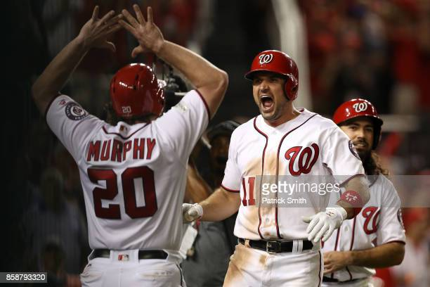 Ryan Zimmerman of the Washington Nationals celebrates with Daniel Murphy of the Washington Nationals after hitting a three run home run against the...