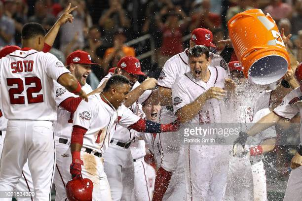 Ryan Zimmerman of the Washington Nationals celebrates with teammates after hitting a walkoff tworun home run against the Philadelphia Phillies during...