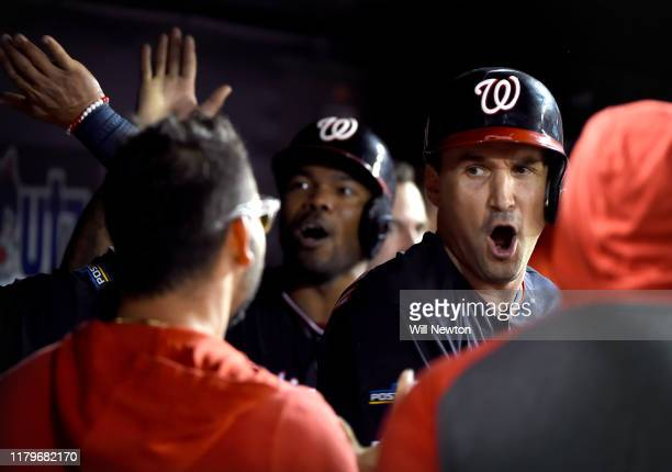 Ryan Zimmerman of the Washington Nationals celebrates with teammates in the dug out after his three run home run in the fifth inning of game four of...