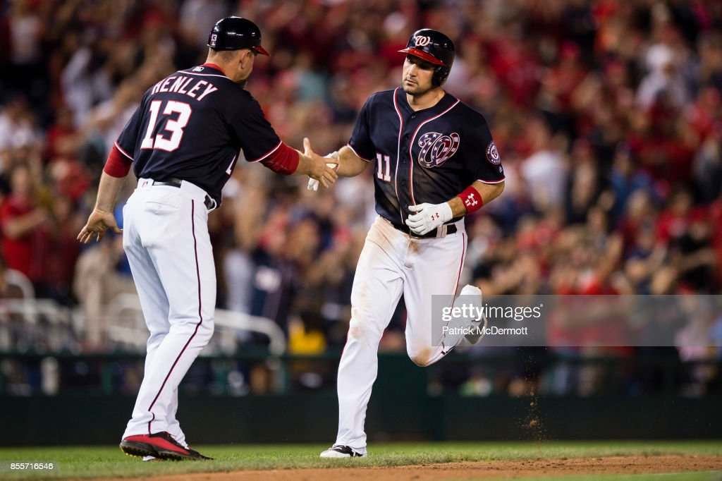 Ryan Zimmerman #11 of the Washington Nationals celebrates with third base coach Bob Henley #13 as he runs the bases after hitting a solo home run in the eighth inning against the Pittsburgh Pirates at Nationals Park on September 29, 2017 in Washington, DC.