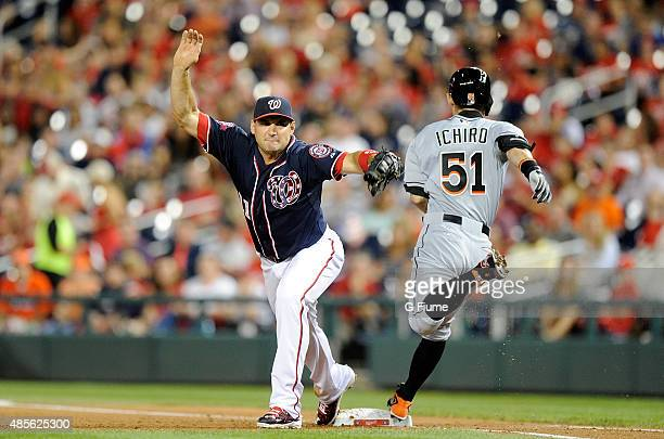 Ryan Zimmerman of the Washington Nationals forces out Ichiro Suzuki of the Miami Marlins at first base in the fifth inning at Nationals Park on...