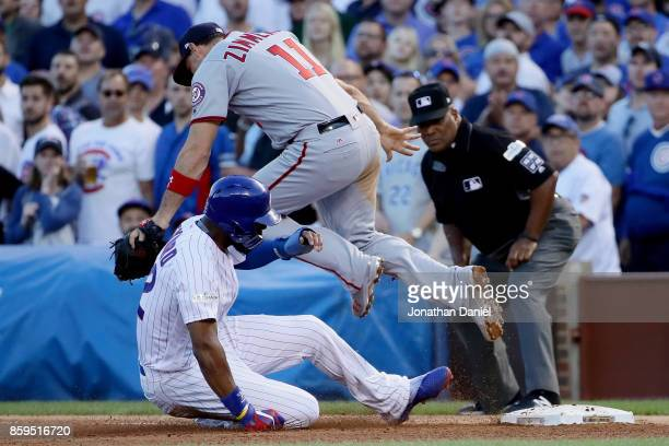 Ryan Zimmerman of the Washington Nationals forces out Jason Heyward of the Chicago Cubs at first base in the seventh inning during game three of the...
