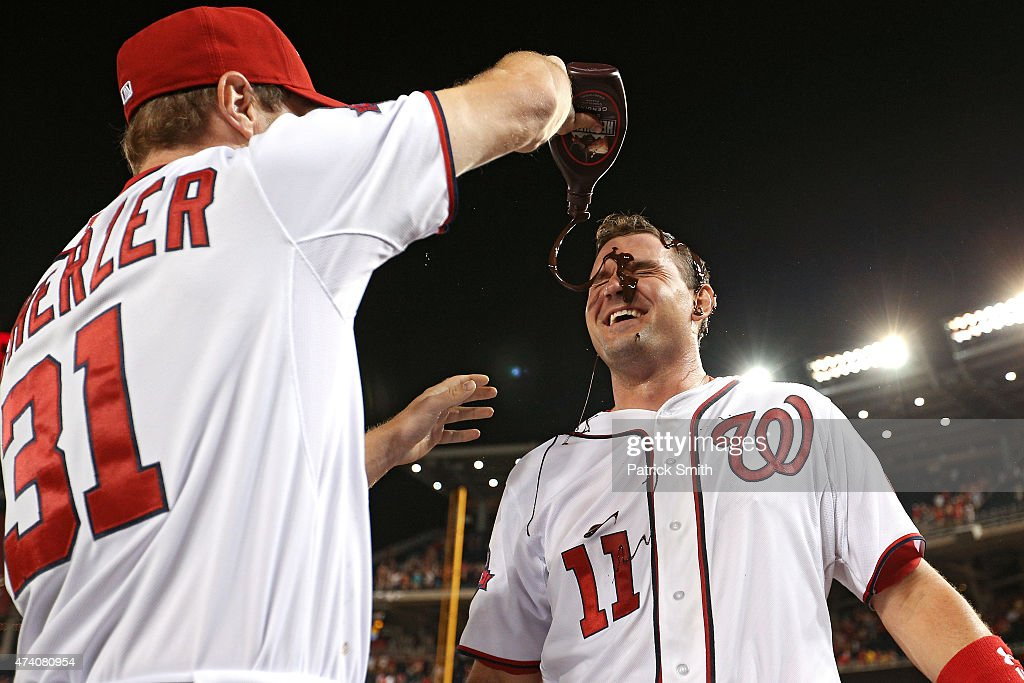 Ryan Zimmerman #11 of the Washington Nationals has chocolate sauce dumped on him by teammate Max Scherzer #31 after hitting a two run walk-off home run in the tenth inning against the New York Yankees at Nationals Park on May 19, 2015 in Washington, DC. The Washington Nationals won, 8-6.