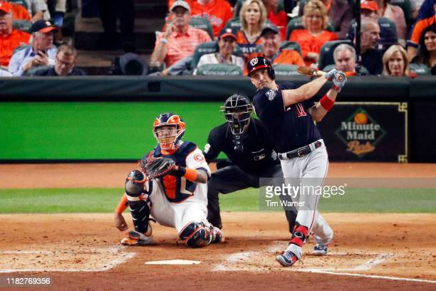 Ryan Zimmerman of the Washington Nationals hits a solo home run against the Houston Astros during the second inning in Game One of the 2019 World...