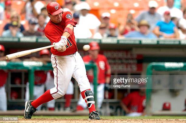 Ryan Zimmerman of the Washington Nationals hits an RBI single in the eighth inning against the St Louis Cardinals on August 5 2007 at RFK Stadium in...