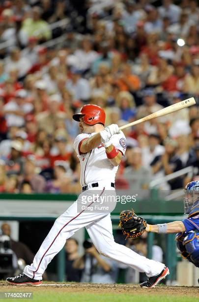 Ryan Zimmerman of the Washington Nationals hits the gamewinning home run in the ninth inning against the New York Mets at Nationals Park on July 26...