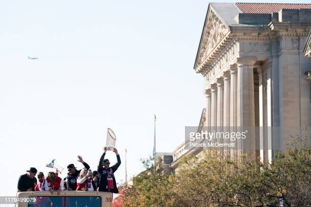 Ryan Zimmerman of the Washington Nationals holds the Commissioner's Trophy during a parade to celebrate the Washington Nationals World Series victory...