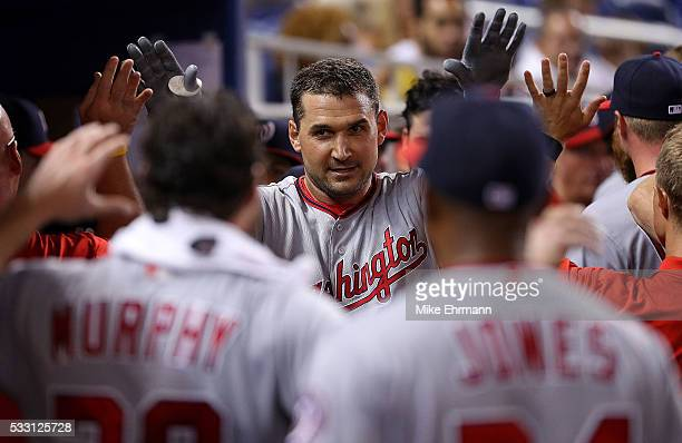 Ryan Zimmerman of the Washington Nationals is congratulated after hitting a solo home run in the second inning during a game against the Miami...