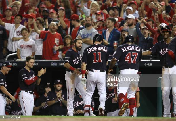 Ryan Zimmerman of the Washington Nationals is congratulated by teammates after his three run home run in the fifth inning of game four of the...