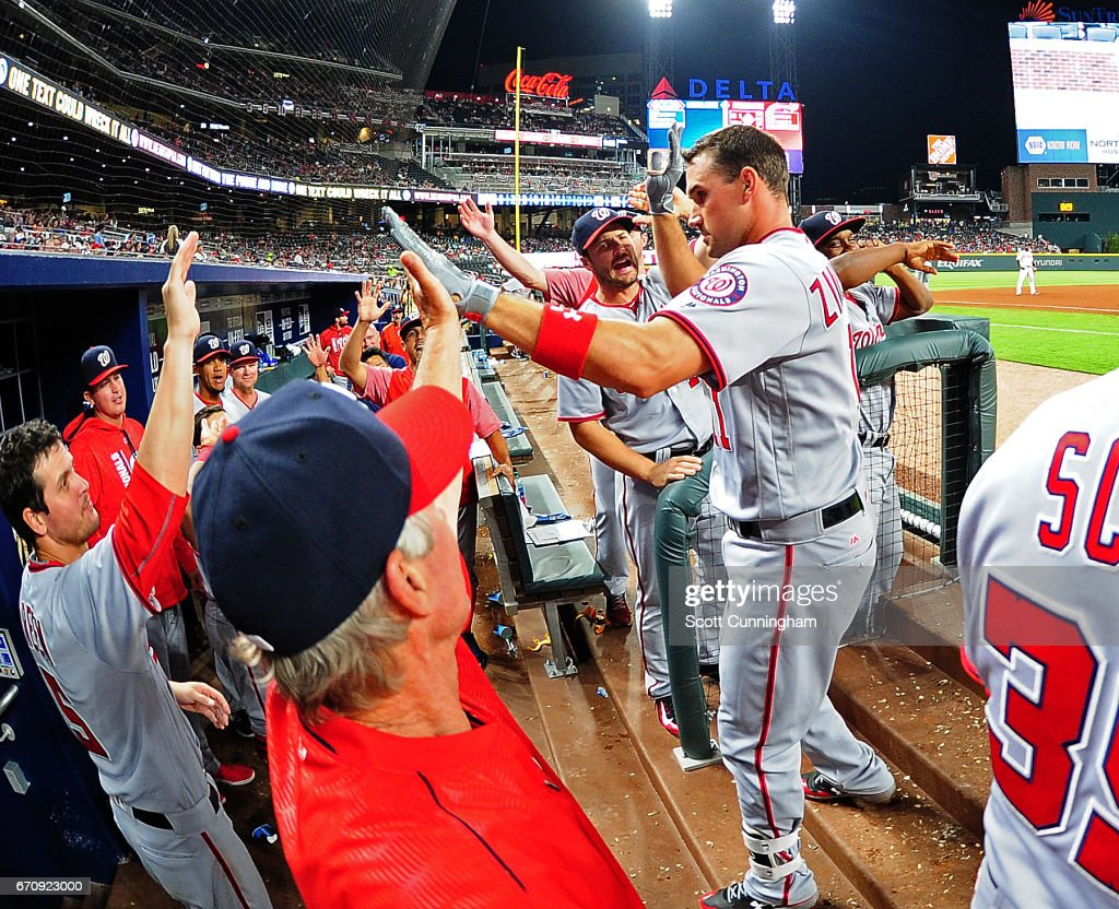 Ryan Zimmerman #11 of the Washington Nationals is congratulated by teammates after hitting a sixth-inning home run against the Atlanta Braves at SunTrust Park on April 20, 2017 in Atlanta, Georgia.