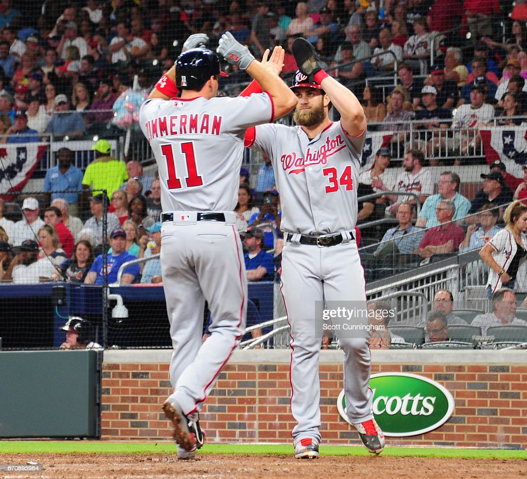 Ryan Zimmerman #11 of the Washington Nationals is congratulated by Bryce Harper #34 after hitting a sixth-inning home run against the Atlanta Braves at SunTrust Park on April 20, 2017 in Atlanta, Georgia.