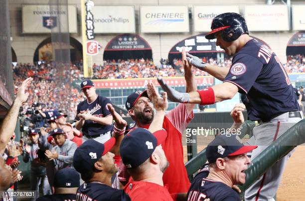 Ryan Zimmerman of the Washington Nationals is congratulated by his teammates after hitting a solo home run against the Houston Astros during the...