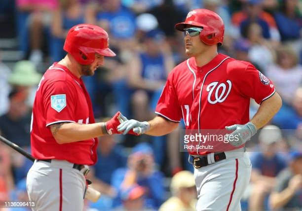 Ryan Zimmerman of the Washington Nationals is congratulated by Matt Adams after he hit a home run against the New York Mets during the second inning...