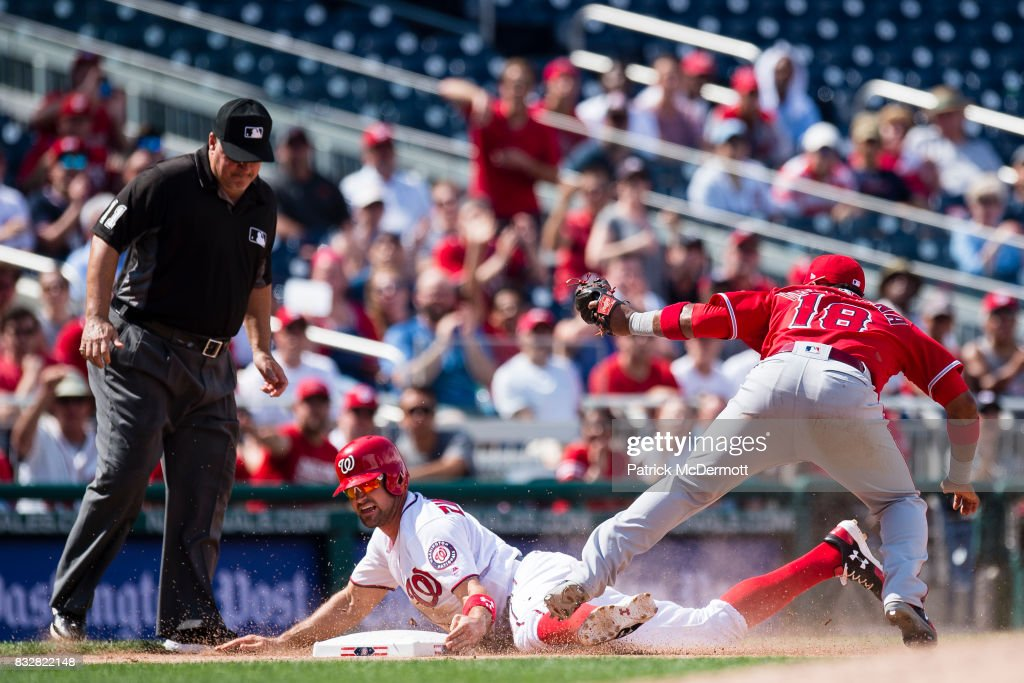 Ryan Zimmerman #11 of the Washington Nationals is tagged out at third base by Luis Valbuena #18 of the Los Angeles Angels of Anaheim in the eighth inning during a game at Nationals Park on August 16, 2017 in Washington, DC.
