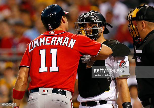 Ryan Zimmerman of the Washington Nationals reacts after being hit by a pitch in the first inning against Francisco Cervelli of the Pittsburgh Pirates...