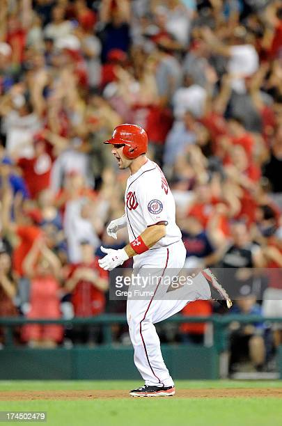 Ryan Zimmerman of the Washington Nationals rounds the bases after hitting the gamewinning home run in the ninth inning against the New York Mets at...